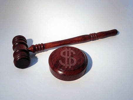 A gavel and penalty symbol