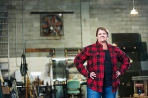 Woman who uses manufacturing inventory software