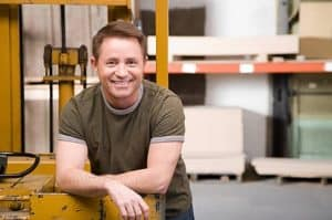 Man who uses small business manufacturing software